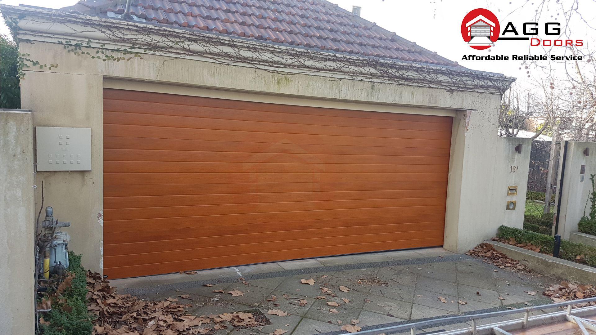 Last Week S B D Panel Lift Installation Australian Cedar Colour Seville Style If You Would Be Intere Wooden Garage Doors Garage Door Panels Wooden Garage