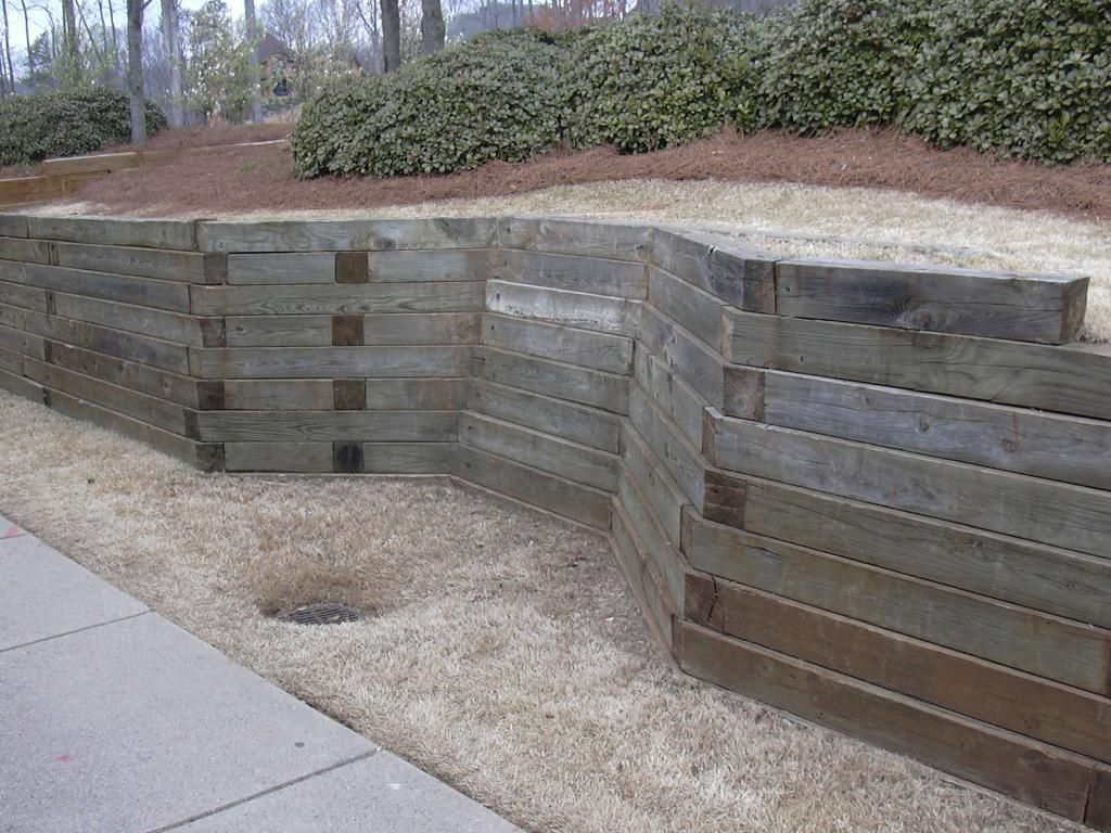 Railroad tie retaining wall design google search for Landscape retaining wall design