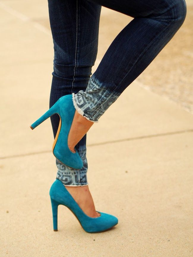 Teal suede pumps and tribal print jeans