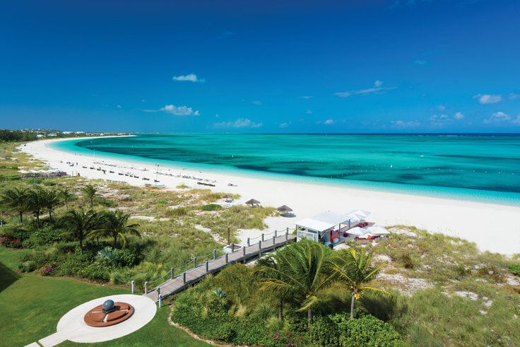 Find Your Own Paradise at These Stunning Turks and Caicos Hotels - There might not be a more alluring tropical getaway than Turks and Caicos, just a three and a half hour flight from NYC. The Caribbean archipelago of low-lying coral islands in the Atlantic is home to a slew of swanky hotels—from the award-winning Grace Bay Beach in the buzzy capital of Providenciales (known as Provo) to the far-flung Parrot Cay. Which is your perfect match? Read on.