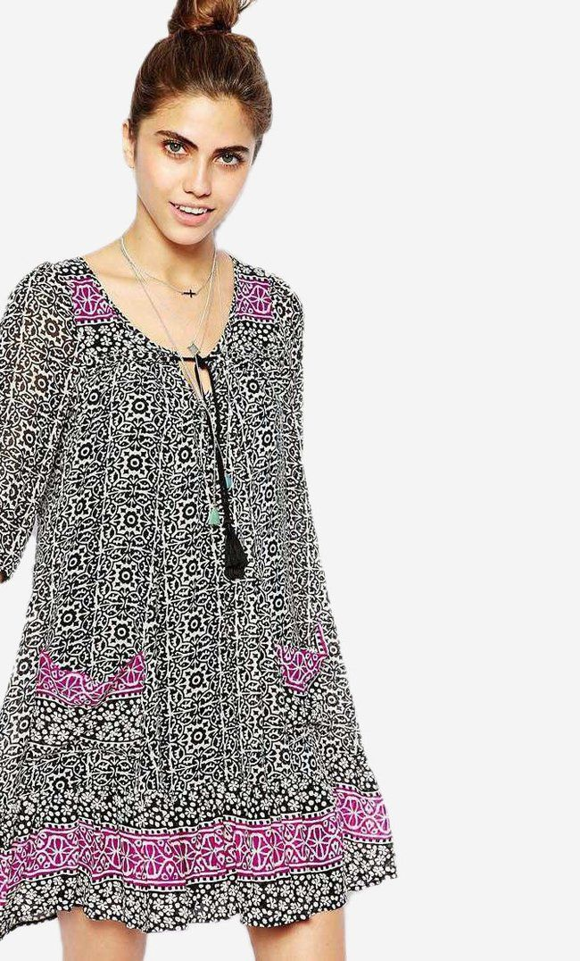 Made from a breathable woven fabric. Scoop neckline. Self-tie rope detail. Relaxed swing shape. Body:...
