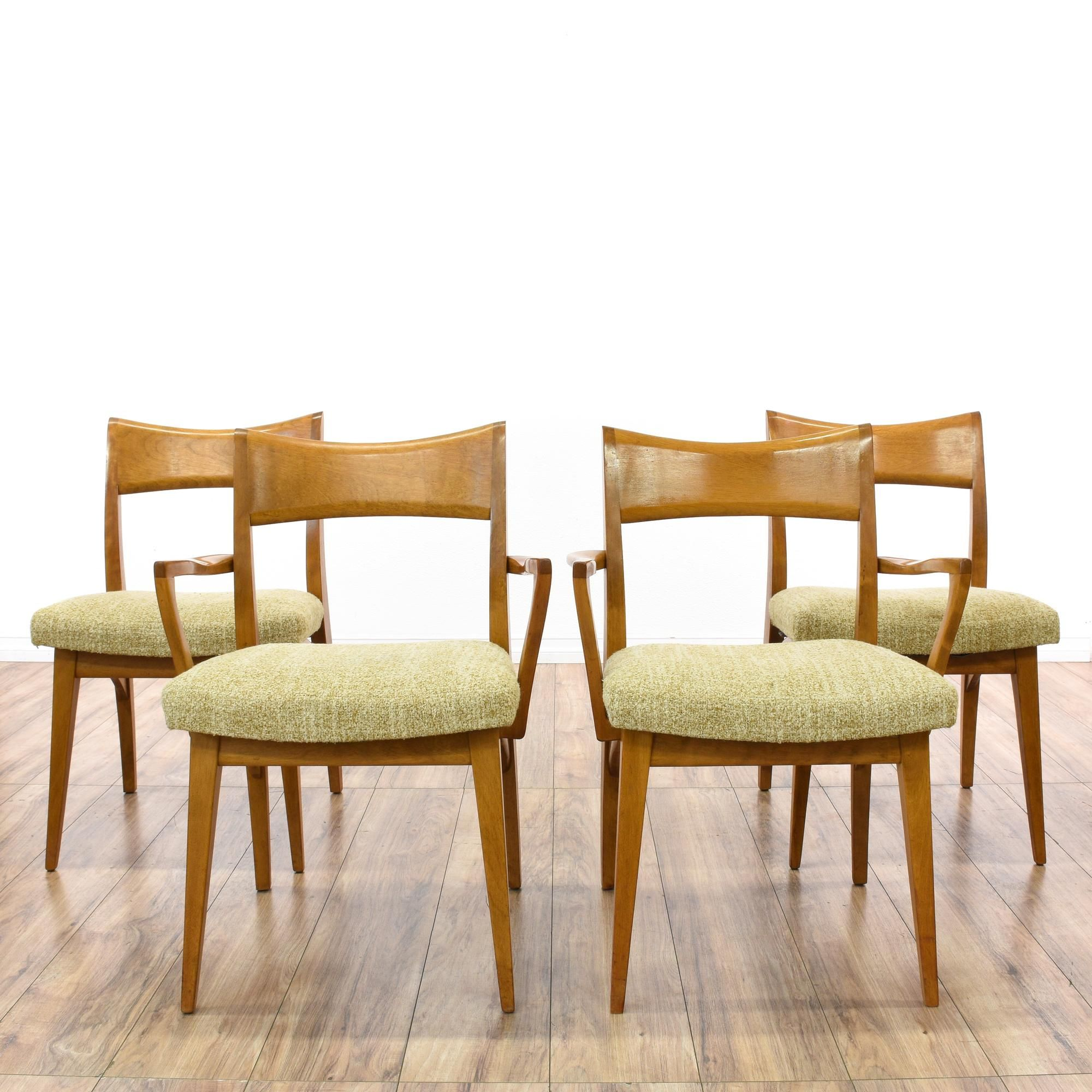 this set of 4 heywood wakefield dining chairs are featured in a