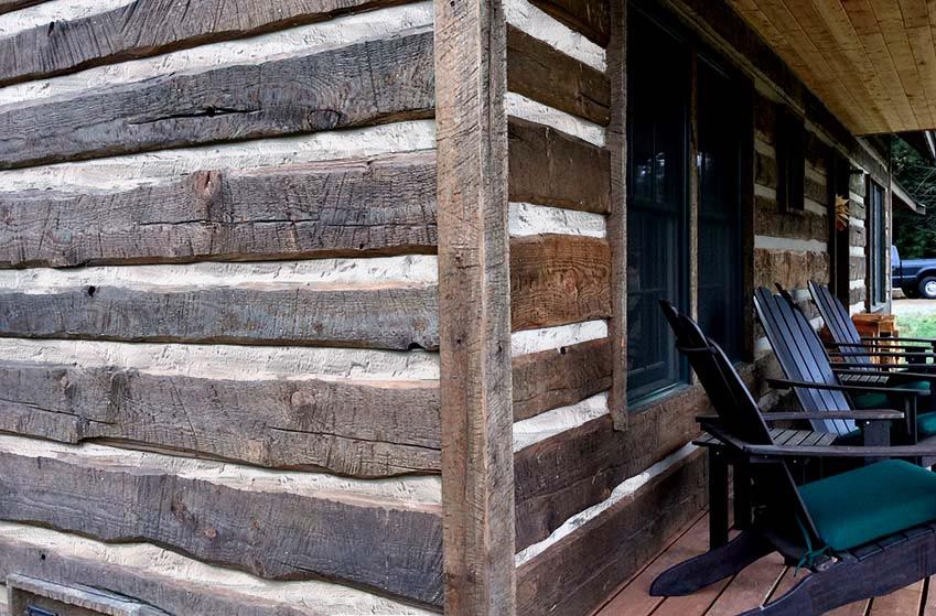 Hand hewn distressed log cabin siding cabin ideas for Hewn log cabin kits