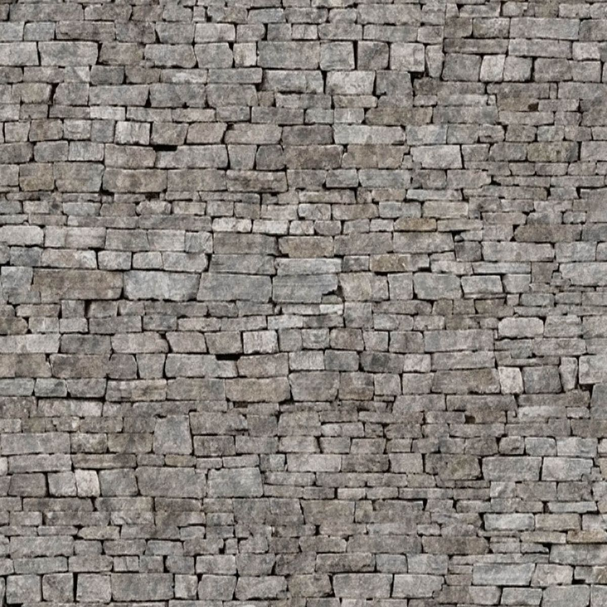 stacked grey stone wall. looks like the side of a castle. | home