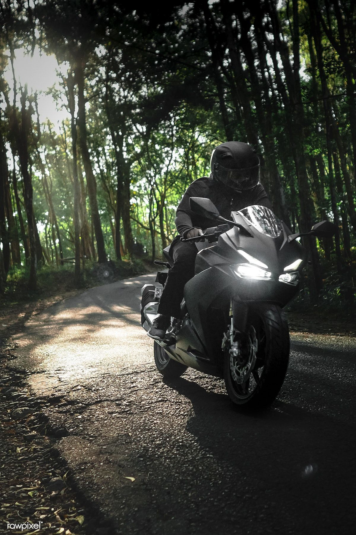 Man On A Motorbike In A Forest In Indonesia Free Image By