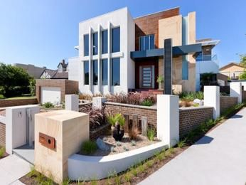 Brick modern house exterior with balcony & ground lighting - House Facade photo 108497