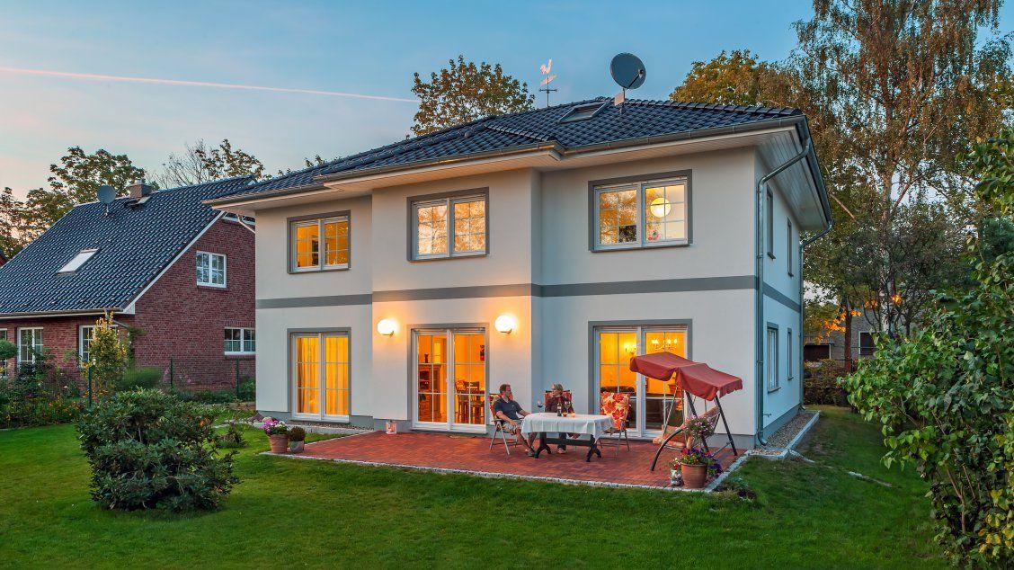 stadtvillen villa lugana putzfassade abendstimmung auf der terrasse hausfassaden. Black Bedroom Furniture Sets. Home Design Ideas