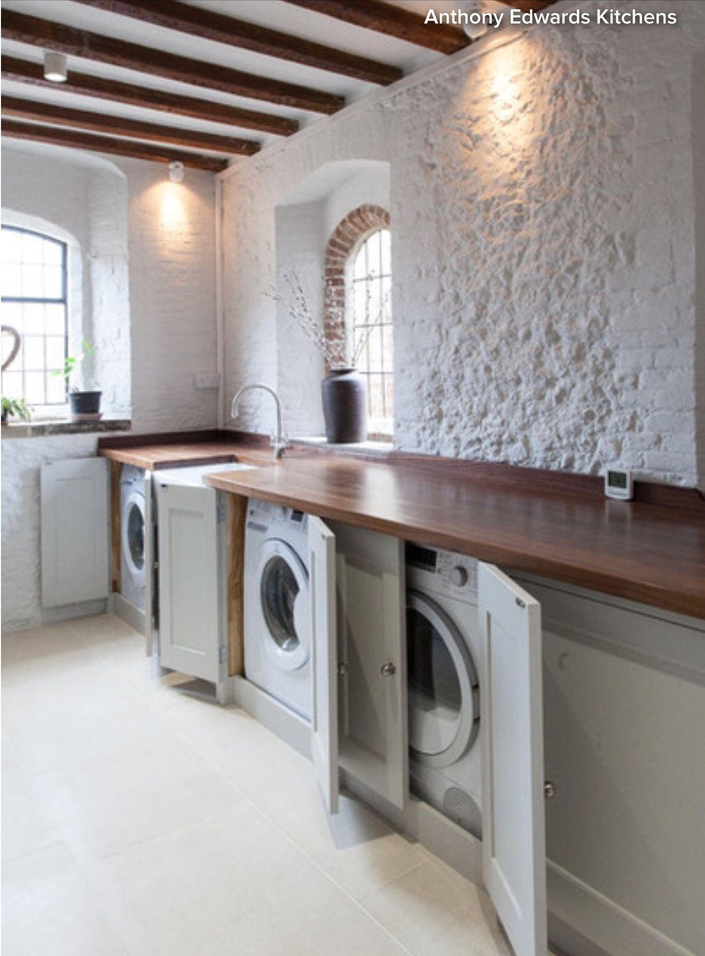 Cupboard doors hiding washing machine and tumble dryer   Small ...