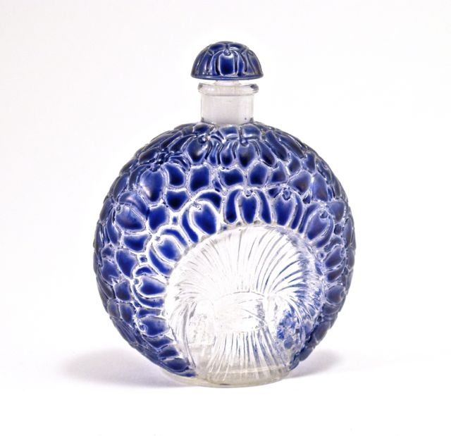 1925 R. Lalique, Gabilla La Violette figural perfume bottle and stopper, clear glass shaped as a bunch of violets, enamel detail. Lalique mark.