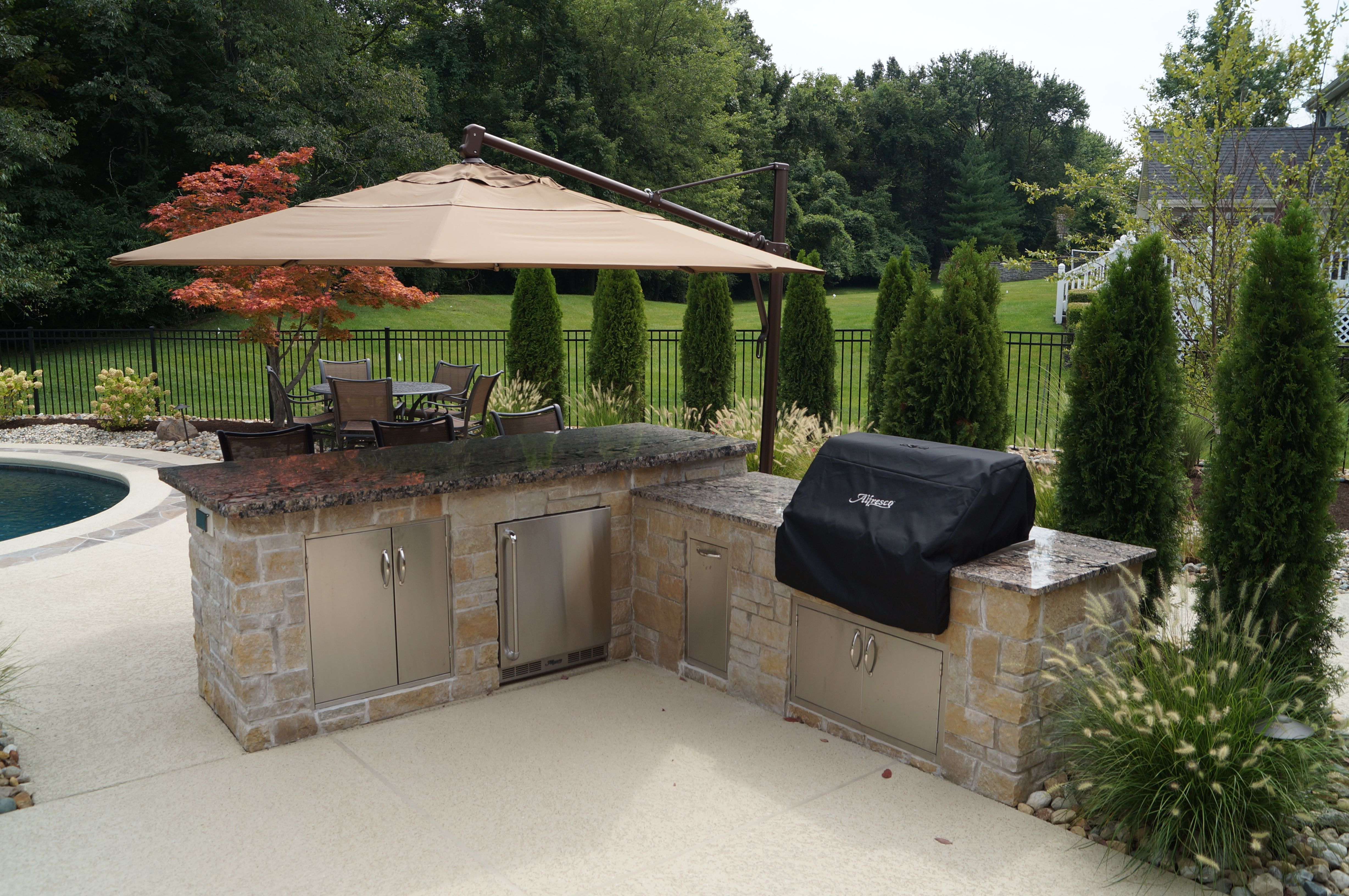 outdoor kitchen. complete with fridge, storage, and a fantastic free