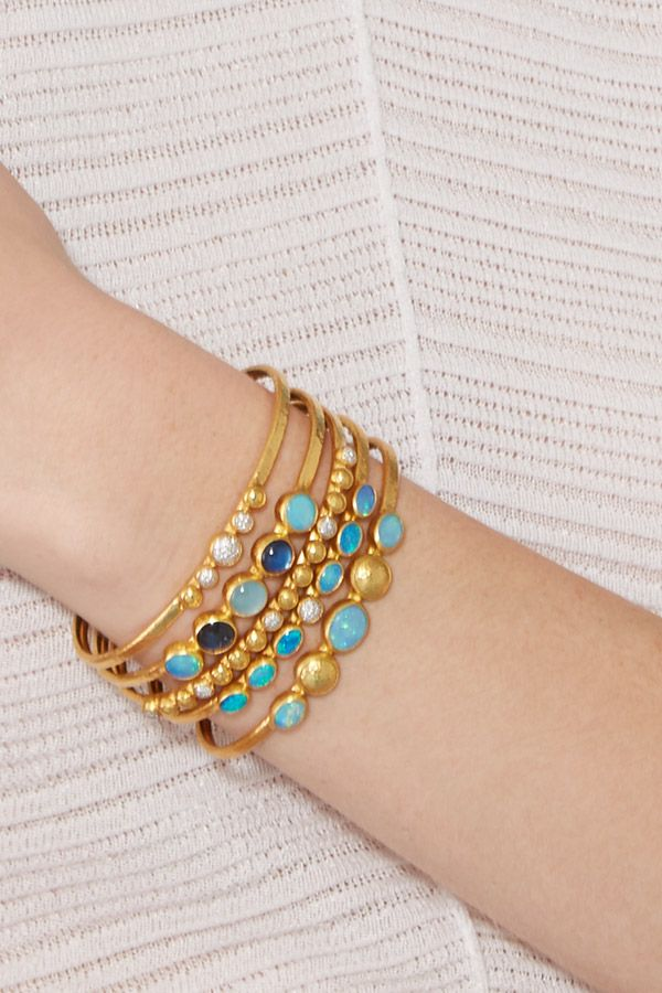 Stack these colorful #Gurhan bracelets for an unique & chic look. #SaksStyle