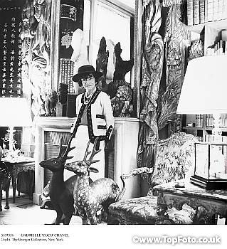 efe045b7ad8 GABRIELLE  COCO  CHANEL (1883-1971). French fashion designer. Photographed  in her suite at the Ritz Hotel in Paris