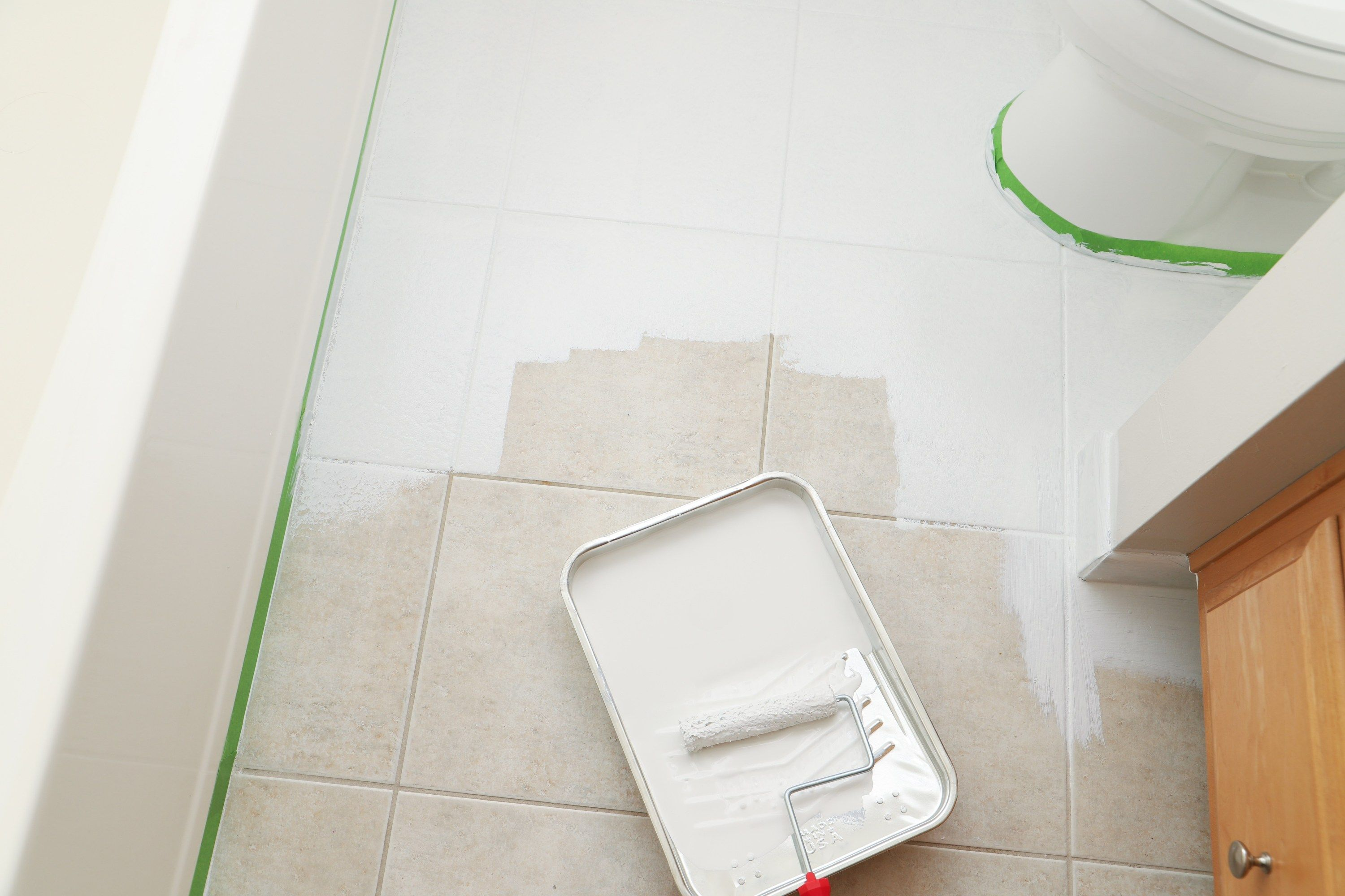 Taping Off Edges For Transformation Of Outdated Tile With Gray And White Rust Oleum Paint Painting Tile Floors Painting Tile Tile Floor Diy