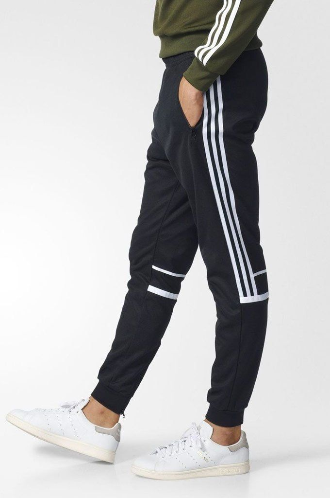 0e8d5d7e7bc Direct from the Adidas archive, these men's track pants modernize an '80s  favorite. They're made with doubleknit fabric and finished with 3-Stripes  that ...