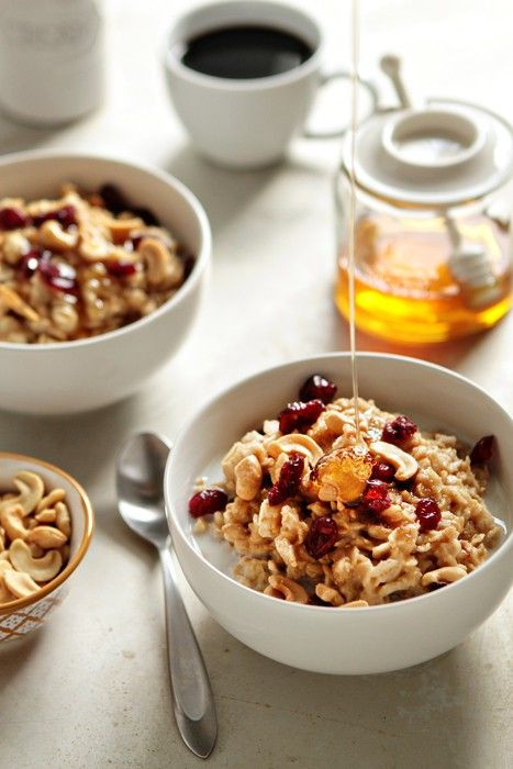 Delicious, homemade oatmeal with cashew butter, cashews, cranberries and honey.