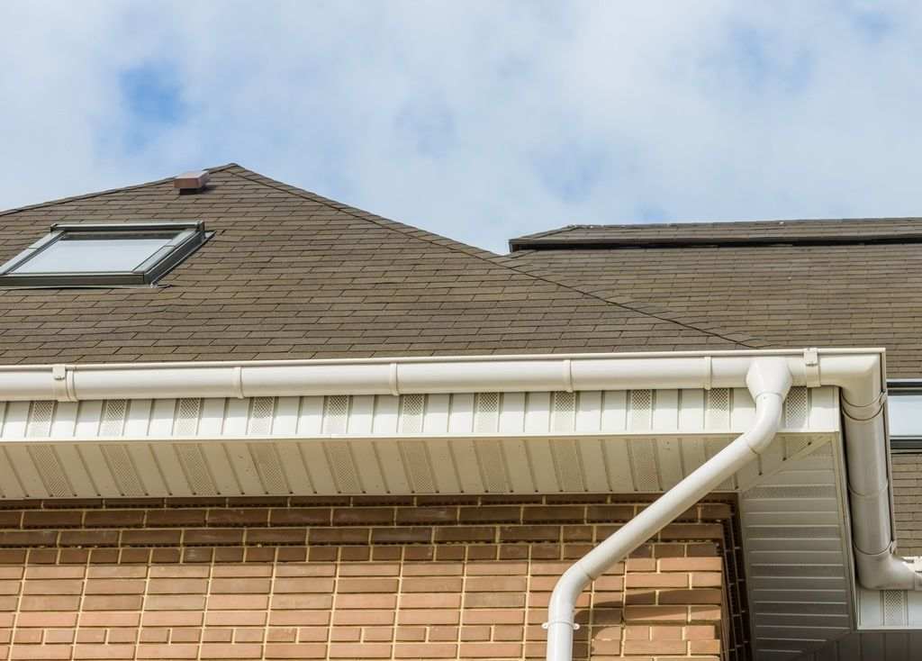 How Much Does It Cost To Clean Gutters Exterior And Roofing How To Gutter Protection Cleaning Garage Doors