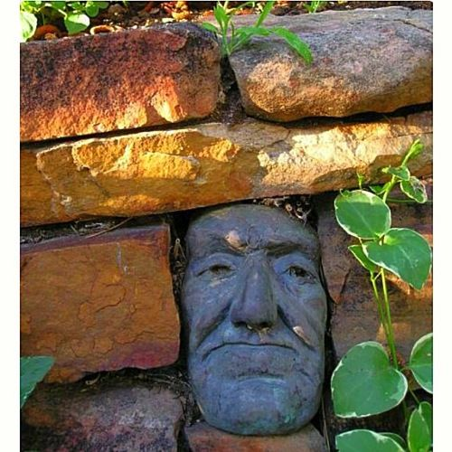 Garden Decor: A Face in the Fence from Boyle Sculptures |  A Gardener's Notebook