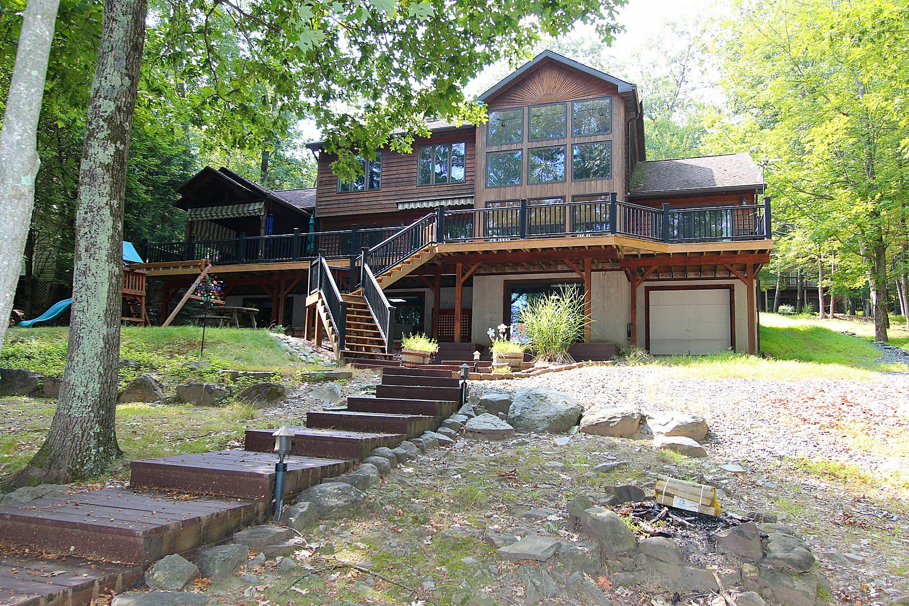 This spectacular home boasts 4000 sq' of finished living space with 88' of lake frontage.  The slope to the water is very gentle....a premium in this hilly terrain around Lake Wallenpaupack