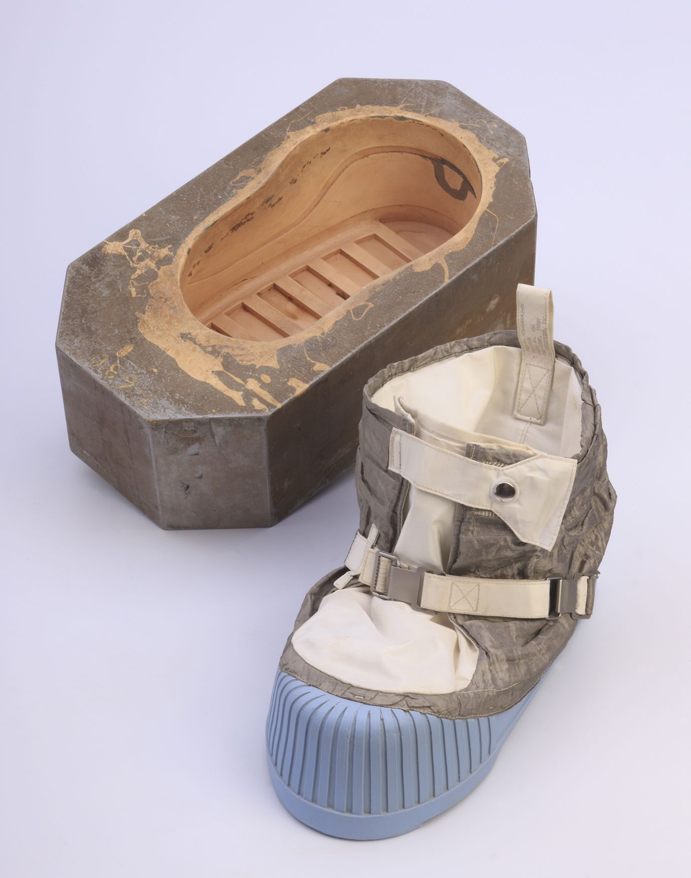 TO ORIGINAL MOLD ADD ORIGINAL MATERIAL The next step was to recreate the  identical silicone material used to produce the original Apollo moon boot  soles. c1040b4c161