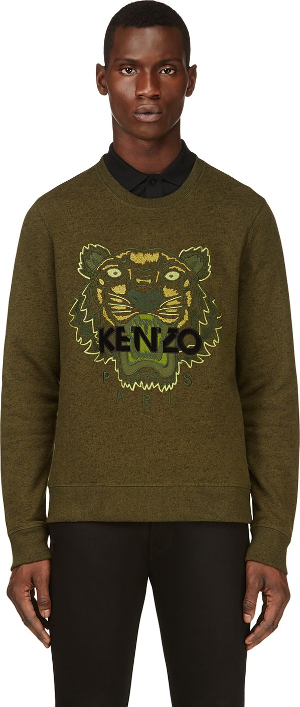 The sweater has a metallic-gold, brown, green, blue and red embroidered tiger front-motif with a centre logo and a matching back tiger-tail. KENZO Blue Striped Tiger Sweatshirt.