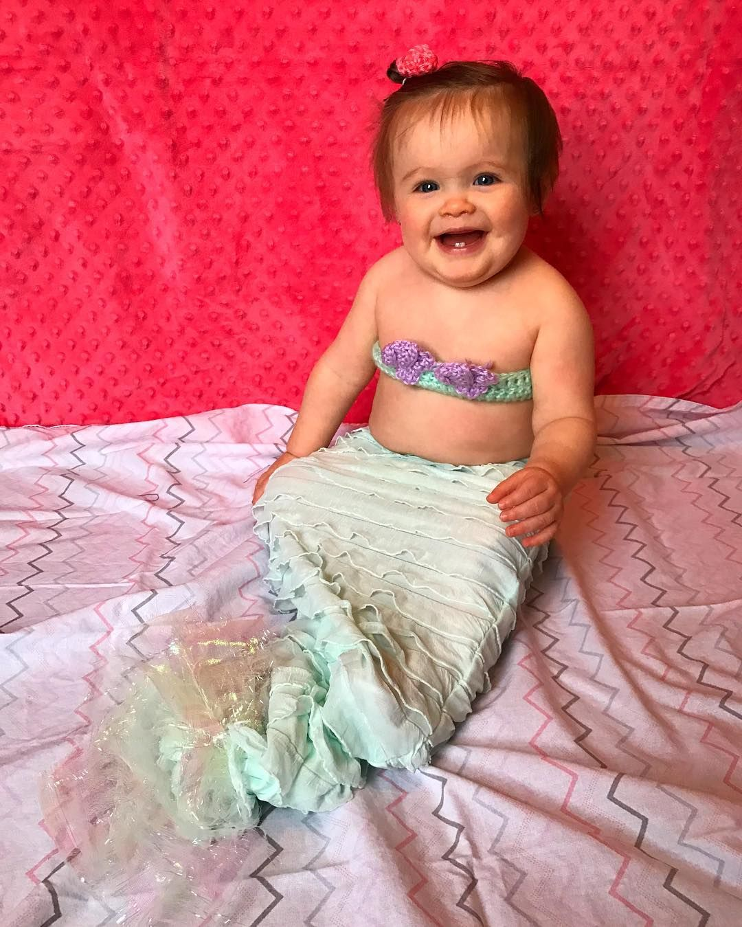 """Mia is 10 months old! (2 days ago)  Weighs 20 pounds  Gives kisses   Bites for attention   Responds """"Yeah!"""" To everything!  Says kitty cat   Says brother   Cutting top 4 teeth  #mermaidmia #monthsofmia"""