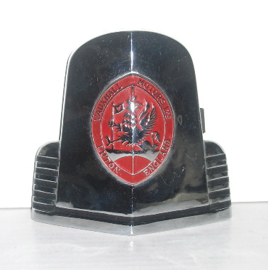 Vauxhall Car Badge - Vauxhall Velox LIP & Wyvern LIX 1948/1951. Pressed stainless steel and red paint. Marked J Fray, B'ham. This one is New Old Stock and in near perfect condition.