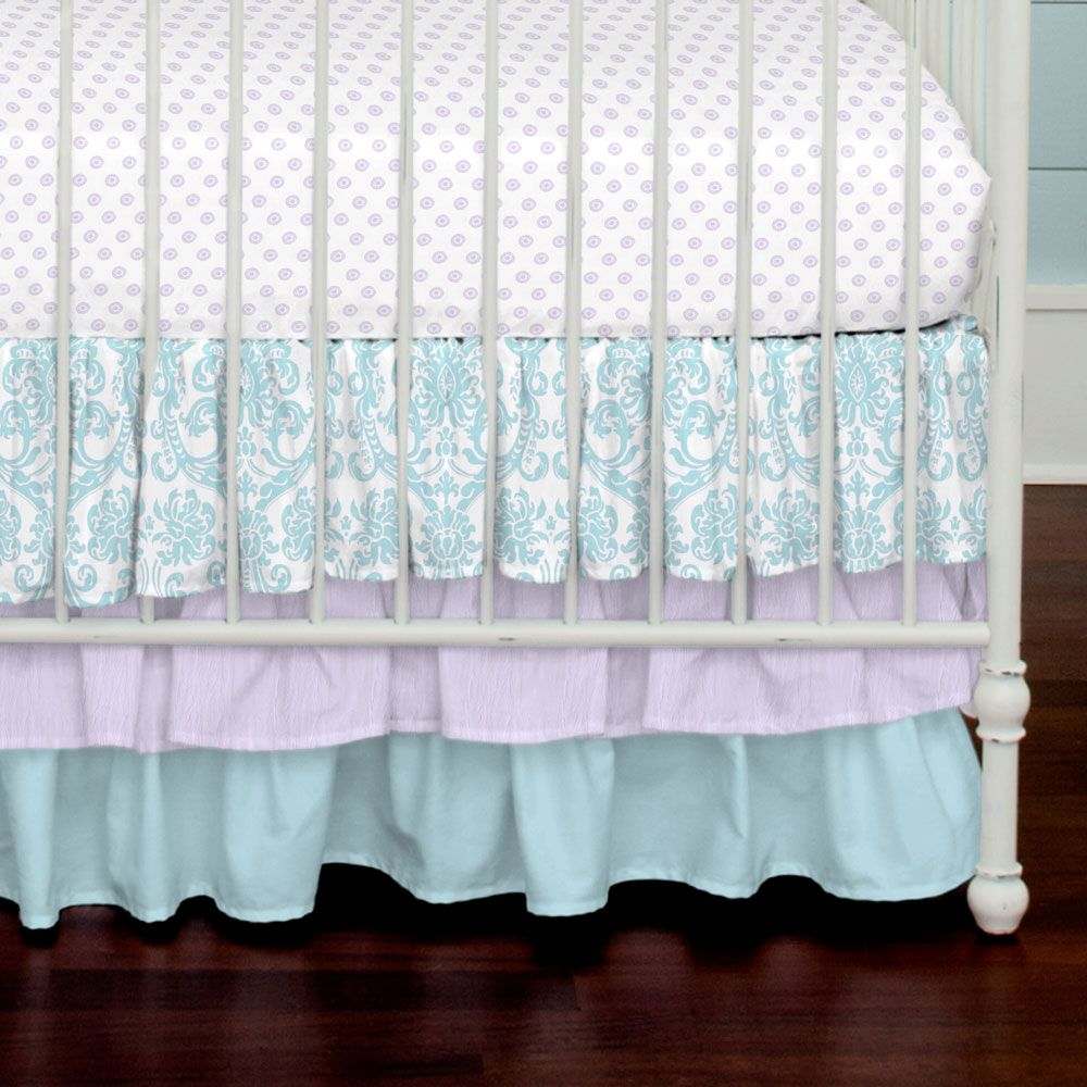 """Crib Bedding Skirt in Aqua and Light Purple Damask by Carousel Designs.  Layer up with our flowing three-tiered crib skirt, perfect for hiding unsightly crib hardware and for putting the final touch on your crib. Finished length approximately 18 inches. Fits standard cribs using mattresses measuring approximately 28"""" x 52""""."""