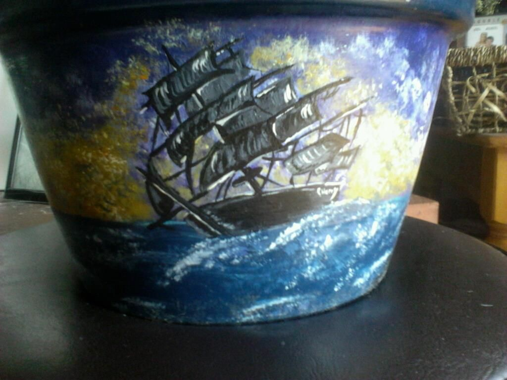 Ship on the lighthouse ship flower pot I painted.