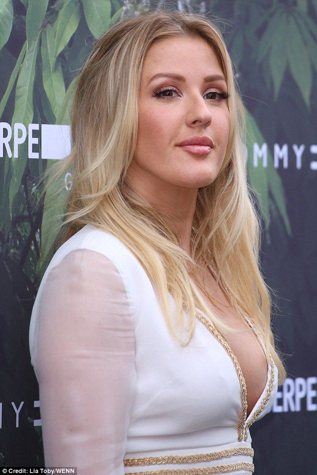 Ellie Goulding dons extremely plunging white maxi dress