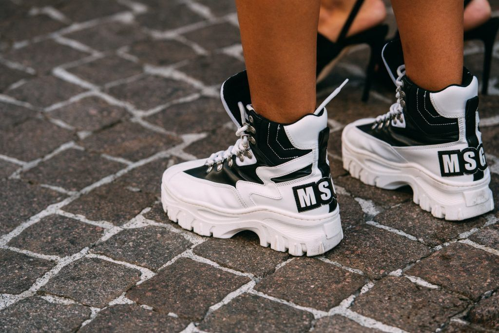 35166efe275 Street Style at Fashion Week  Best Photos from MFW Spring 2019 – Footwear  News MGSM Trainers