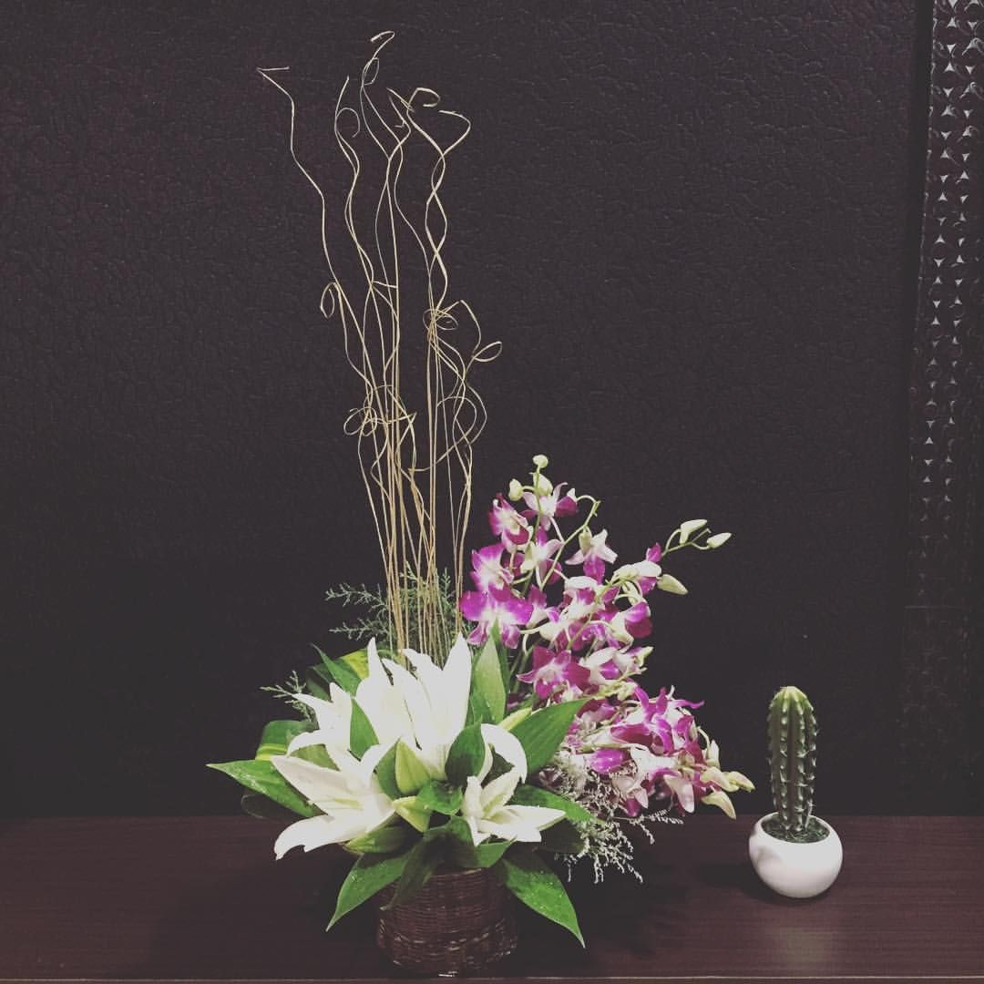 White Lilies And Purple Orchids Arrangement Delivered Once Again To