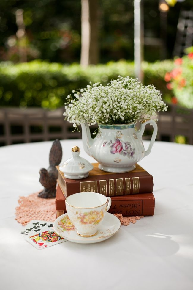 Love the baby's breath in a tea pot! Our moms have these as gifts they got  in RO!) Alice in Wonderland reception with tea party centerpieces - Caitlin  ...