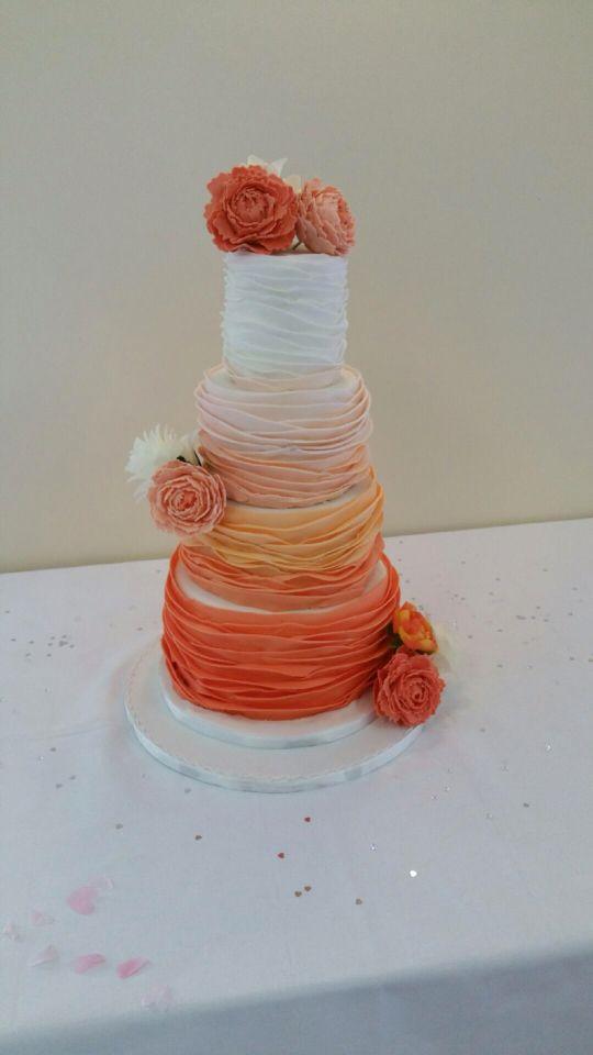 Ombré ruffle effect wedding cake with handmade peonys