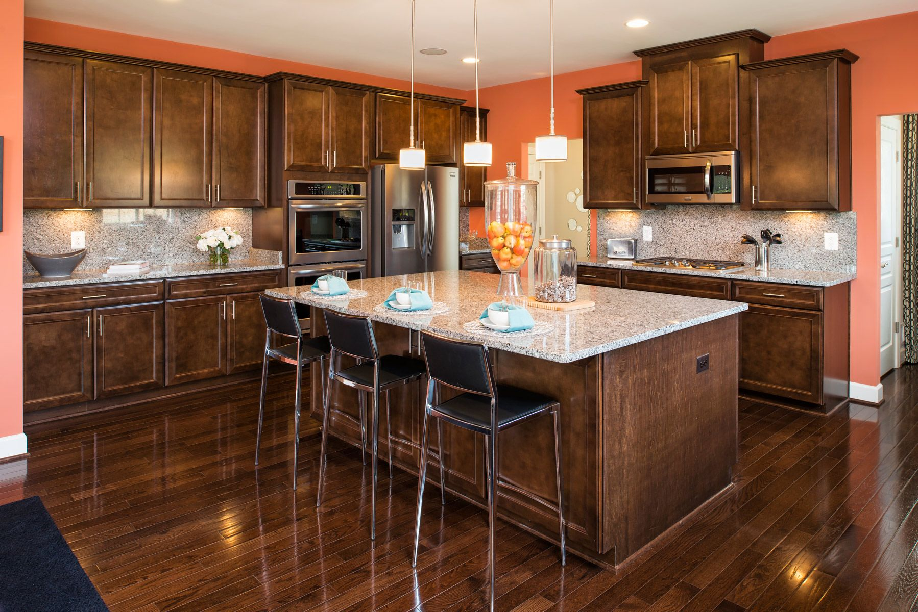 Love The Coral Paint Behind The Dark Cabinets The Chatham At Marlboro Riding Home Kitchens Kitchen Design Coral Kitchen