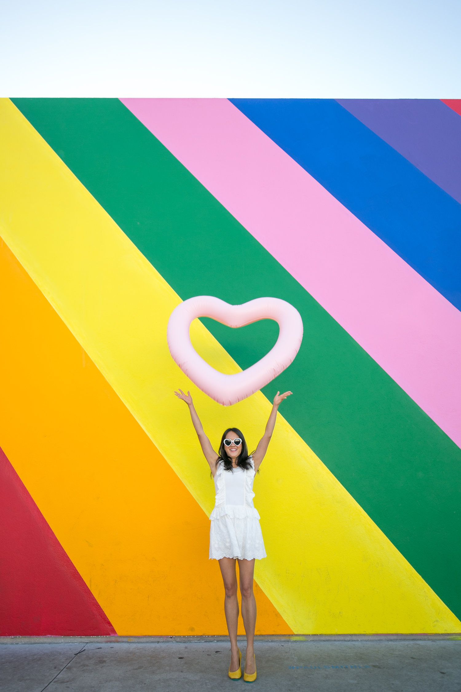 Photoshoot at the los angeles rainbow wall with amy tangerine