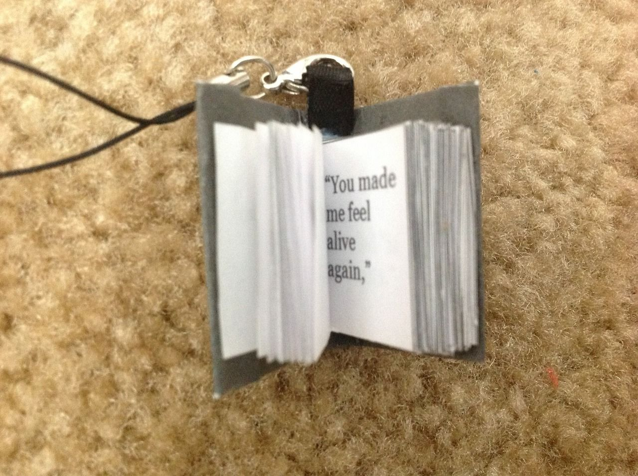 book charms with quotes from the book in it