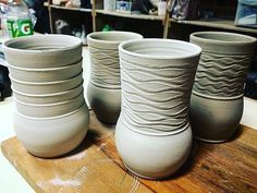 Here's what happens when you throw a bunch of cylinders in a panic because your firing is coming up soon and you don't have anything ready. But then you find out the firing's later than you thought it was so you chill....and forget to put handles on all those cylinders. #winecups #ihaveadozenmore #handmade #wheelthrown #pottery #cups #ceramics #planning