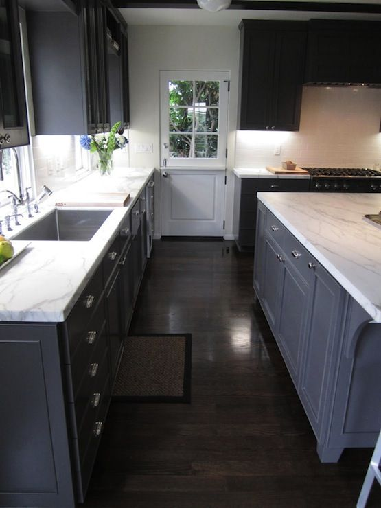 dark hardwood floors and grey walls shaped kitchen