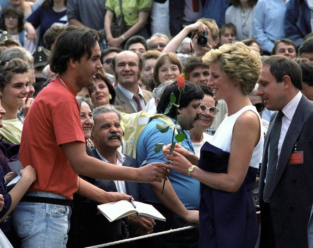 Britain's Diana, Princess of Wales receiving a red rose ...