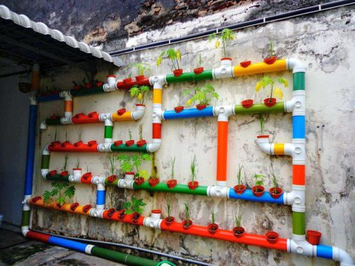 Perfect Vertical Vegetable Garden In Brightly Painted PVC Pipes And Pots (via  Milkwood Permaculture Blog)