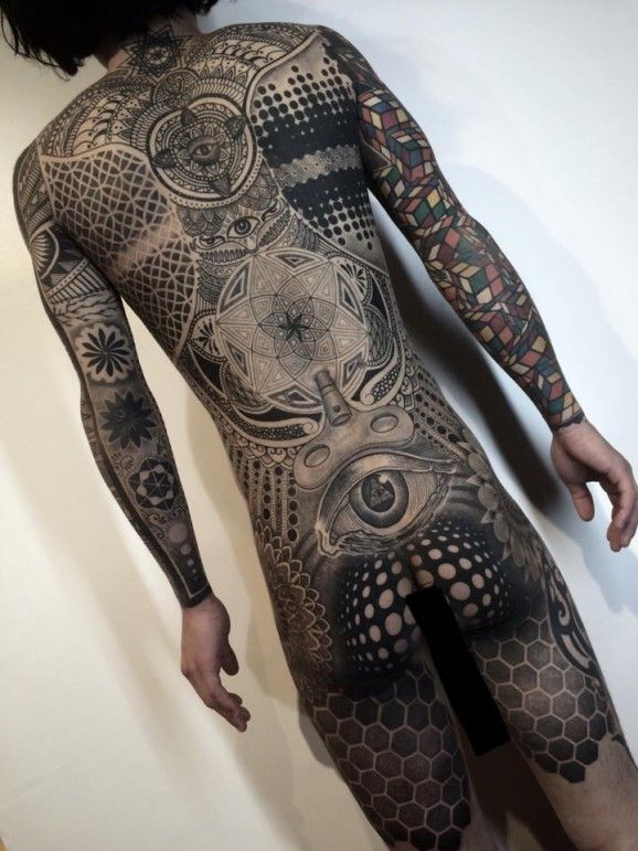 4621f675a2674 Tattoo artist Nissaco almost broke the internet with his out of this world  geometric bodysuit.
