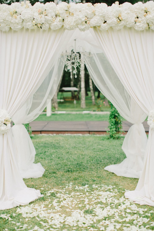 White wedding arbor with chandelier