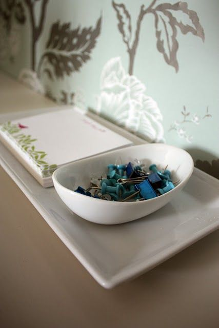 Using pretty bowls for office supplies makes your desk look lovely.