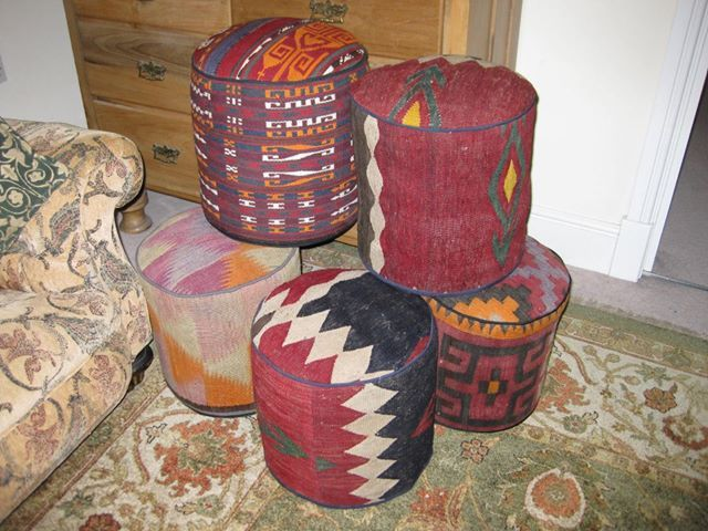 (BrandonRugs.com) Kilim covered footstools like these are inexpensive, casual room accesories that pack a lot of exciting color and design with a small foorprint. And they're versatile, working with a range of decorating styles from rustic primitivism to avant-garde modernism.