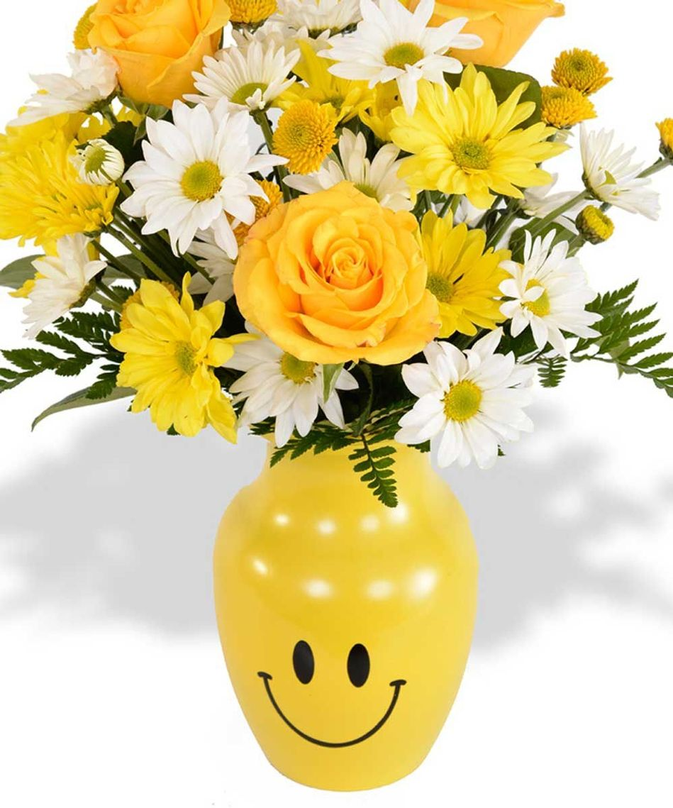 Bright #yellow #smiley face vase filled with a mix of #yellow and ...