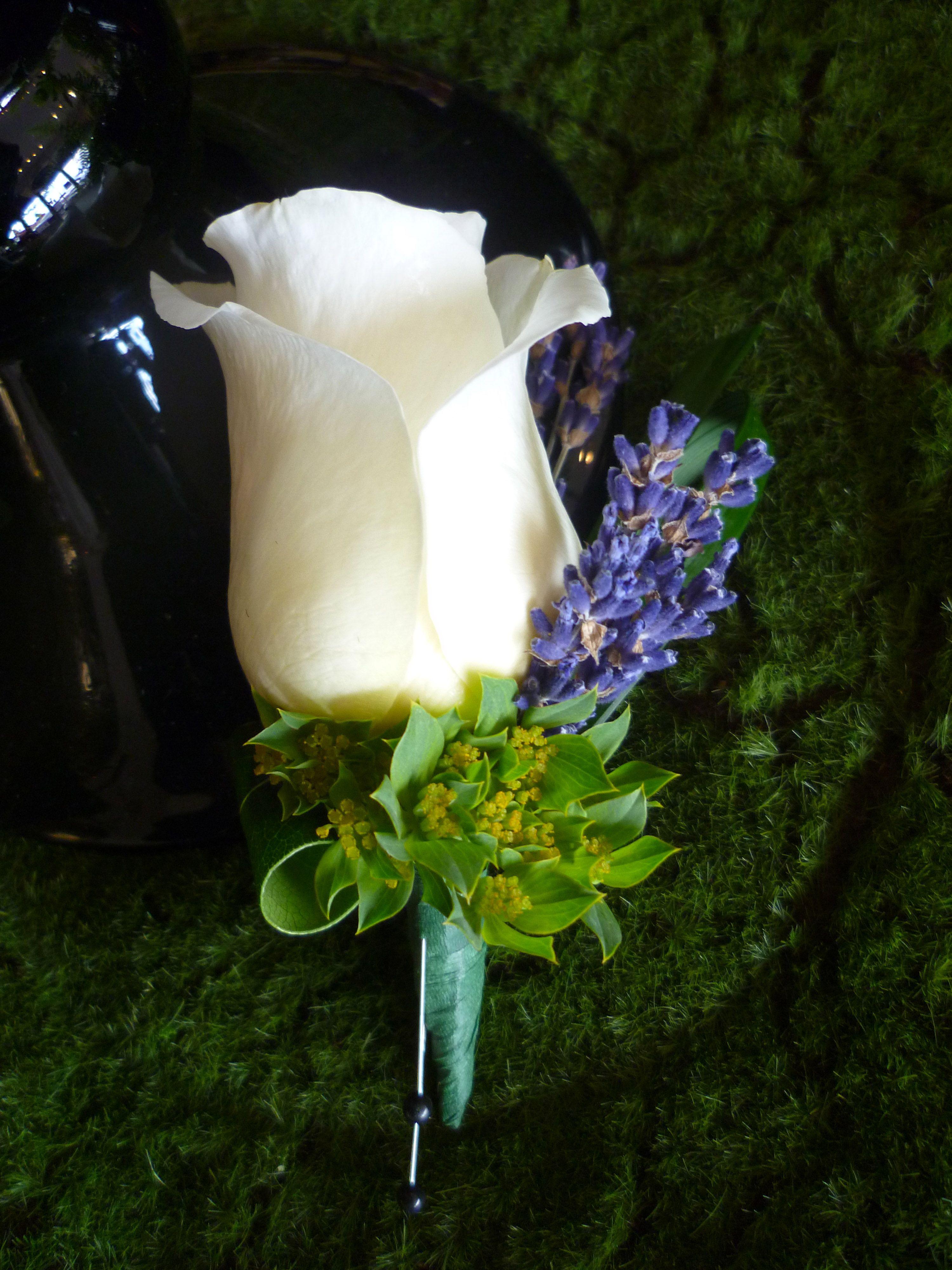 White rose and lavendar boutonniere