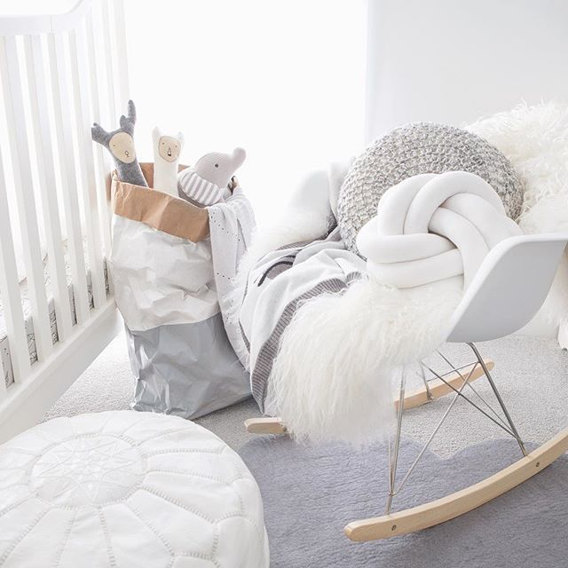 Gorgeous White Nursery With A Comfy Eames Rocking Chair