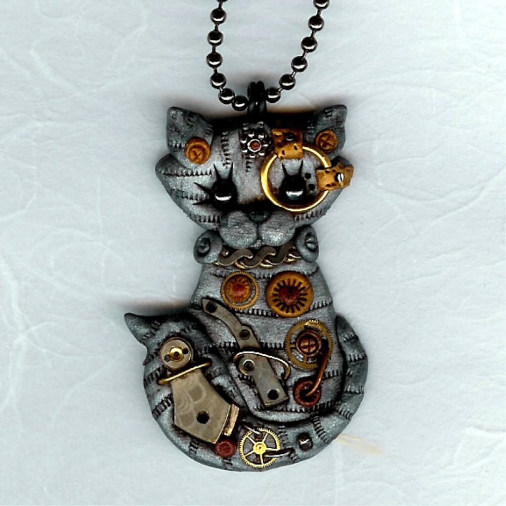 Steampunk Silver Gray Tabby Kitty Cat Necklace Polymer Clay Jewelry. $24.00, via Etsy.