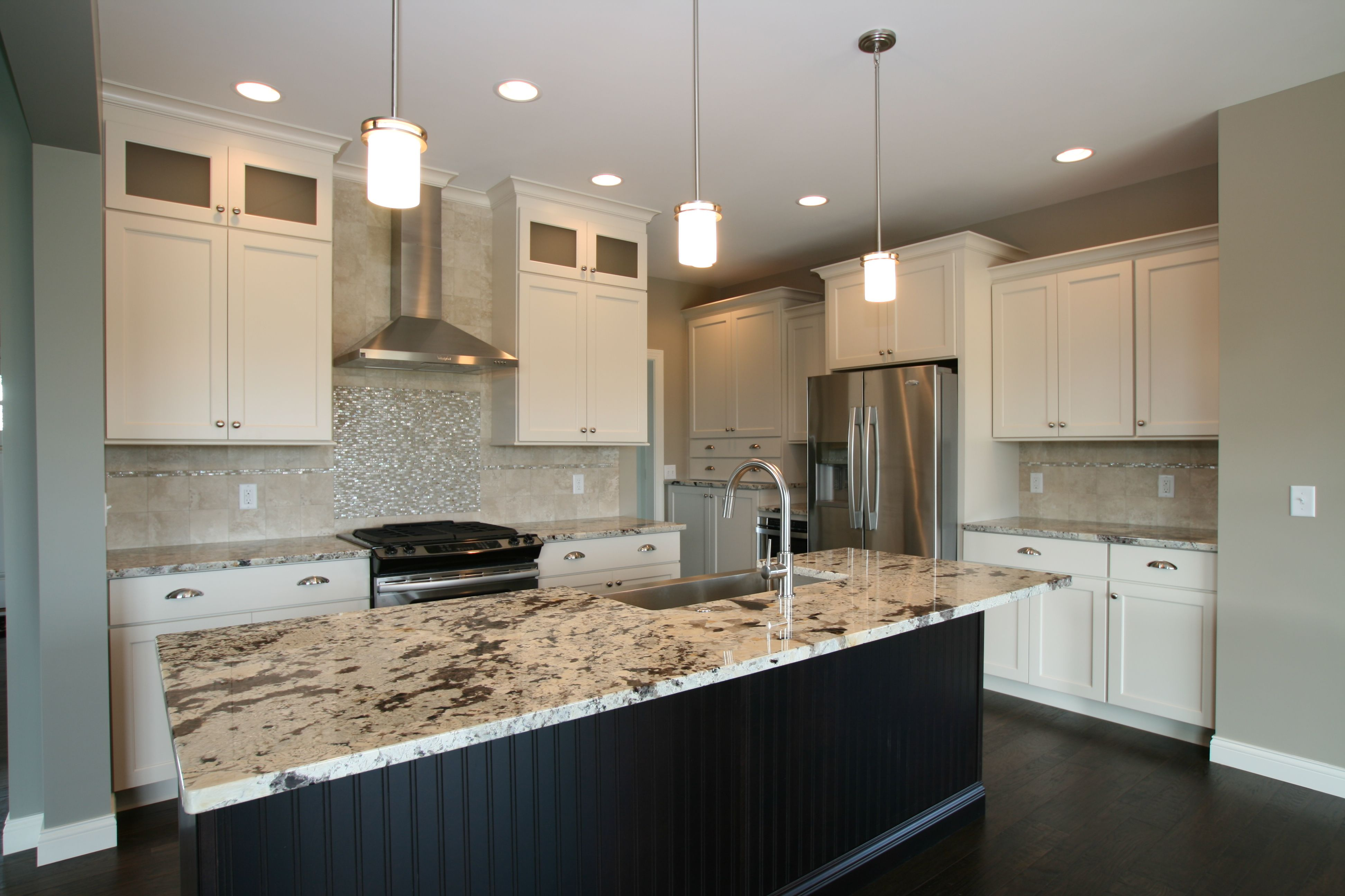 Transitional white painted kitchen with stainless steel for Aspen kitchen cabinets