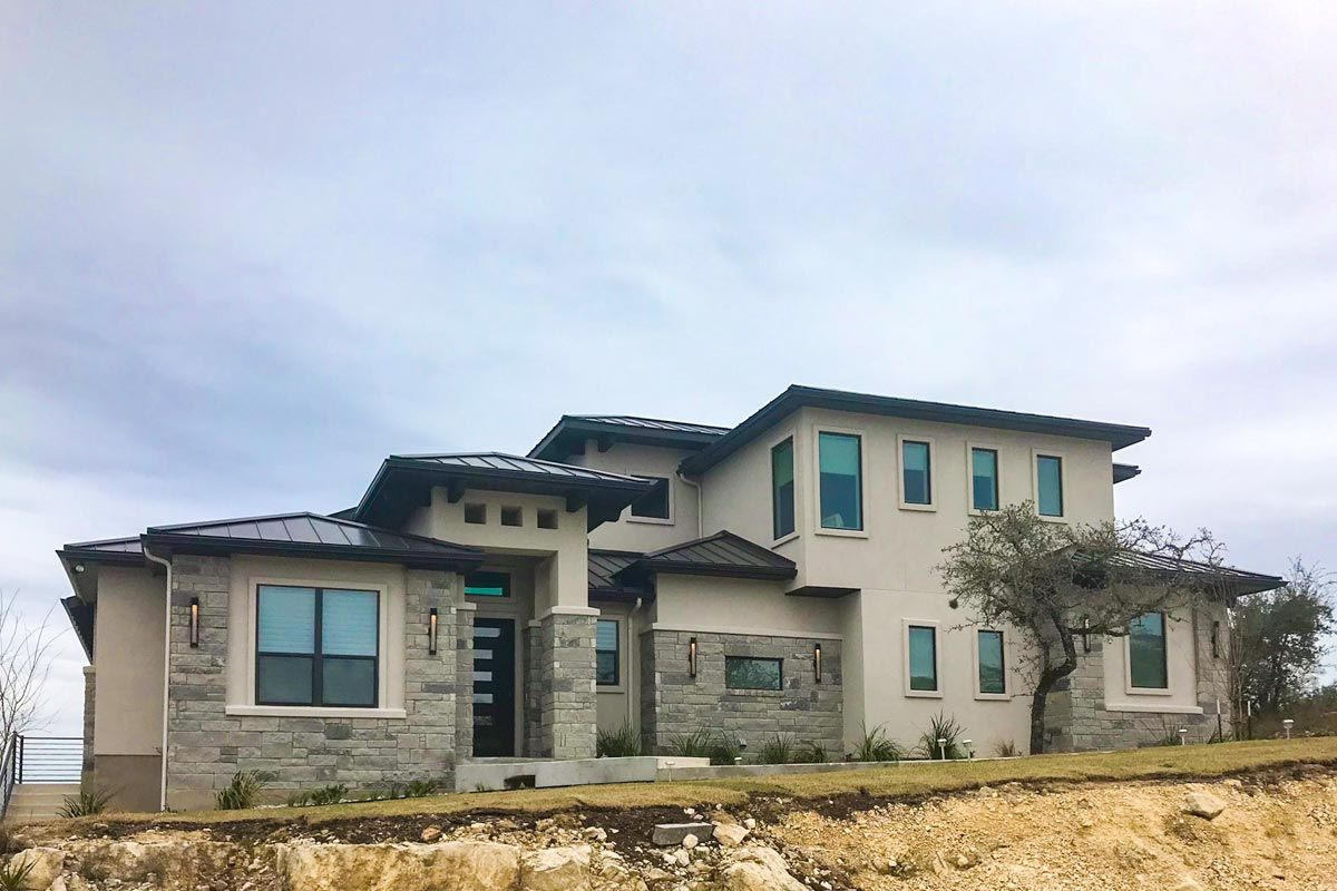 Contemporary 3 Bedroom Stone and Stucco Home Plan with Private Study